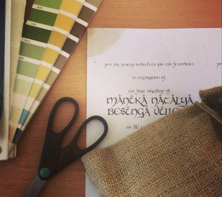 Testing colors, fabrics, and fonts. I even tried staining paper with coffee to create a weathered looking invitation.