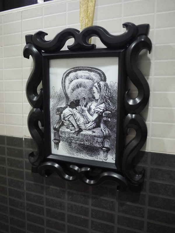 I must admit, I rip off illustrations from the internet and frame them. I initially thought of hanging vintage Through the Looking Glass illustrations for the nursery, but the period from which this drawing came and the pen and ink style kind of blended with our art nouveau-ish bathroom, so I hung it here.