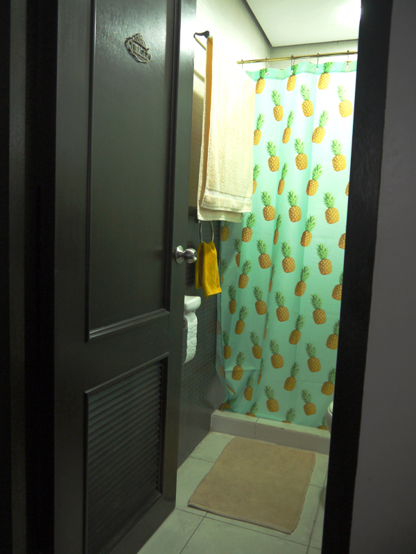 Yellow bath and hand towels, and yellow floor mats from our own closet