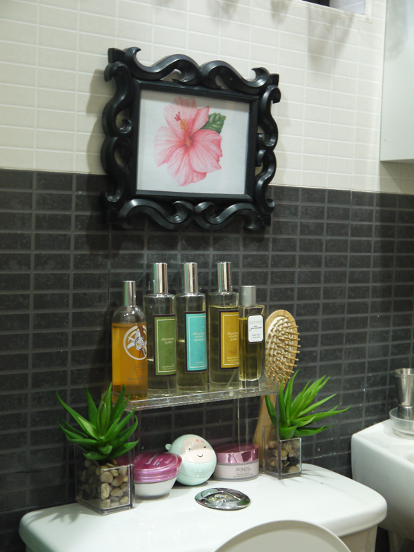 The illustration of a pink gumamela (hibiscus) is by Cynthia Rothbard. As I mentioned earlier, all the toiletries that used to litter the top of the water closet were kept inside the medicine cabinet, and I just retained those that used colors from my  palette. A good exercise on how everyday functional items can also contribute to your room's overall look.