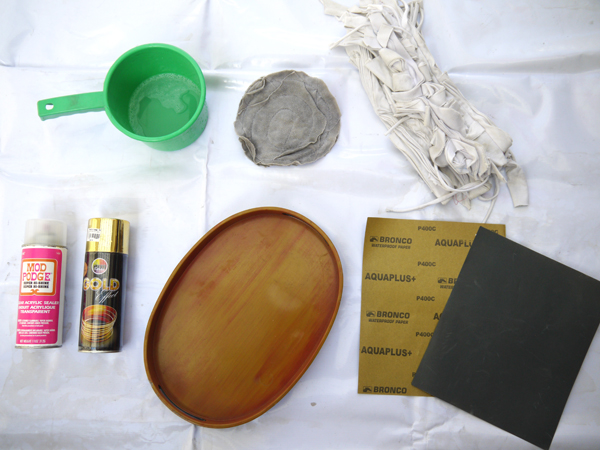 Clockwise, from top left: soapy water, a wet rag, a dry rag, sandpaper (I used 400 grit), your tray, spray paint, and a clear acrylic sealer. And of course, don't forget your drop cloth, newspapers, or an old tarpaulin.