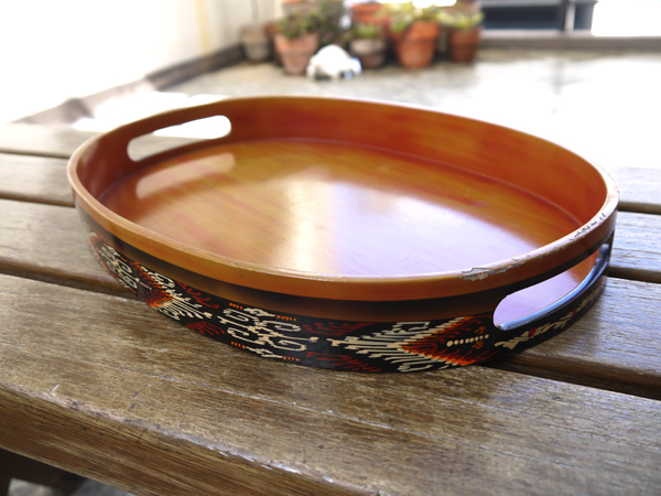 This wood veneer tray is painted with the t'nalak motif around it.