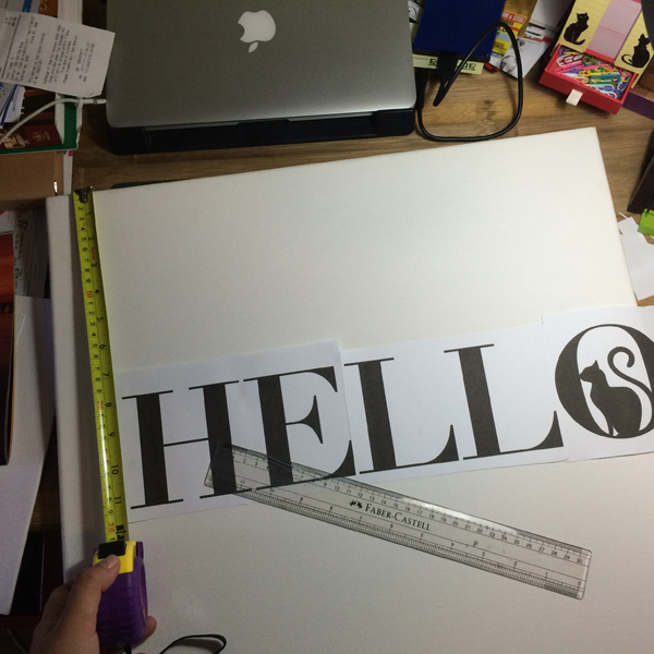 I checked first if the stencil I printed out fit my canvas, and I marked the exact spot where I would be placing each letter.