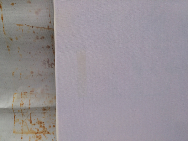As you can see, the darker marks were still slightly visible beneath the paint.
