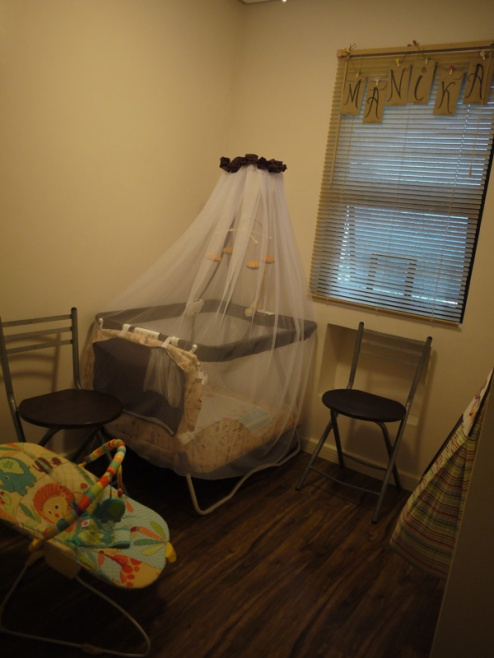 Here's what her nursery looked like before she popped out of the oven. You can see it's a pretty small room, but she doesn't seem to mind.
